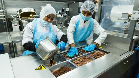 Chefs at Bangi Golf Resort vacuum packing food
